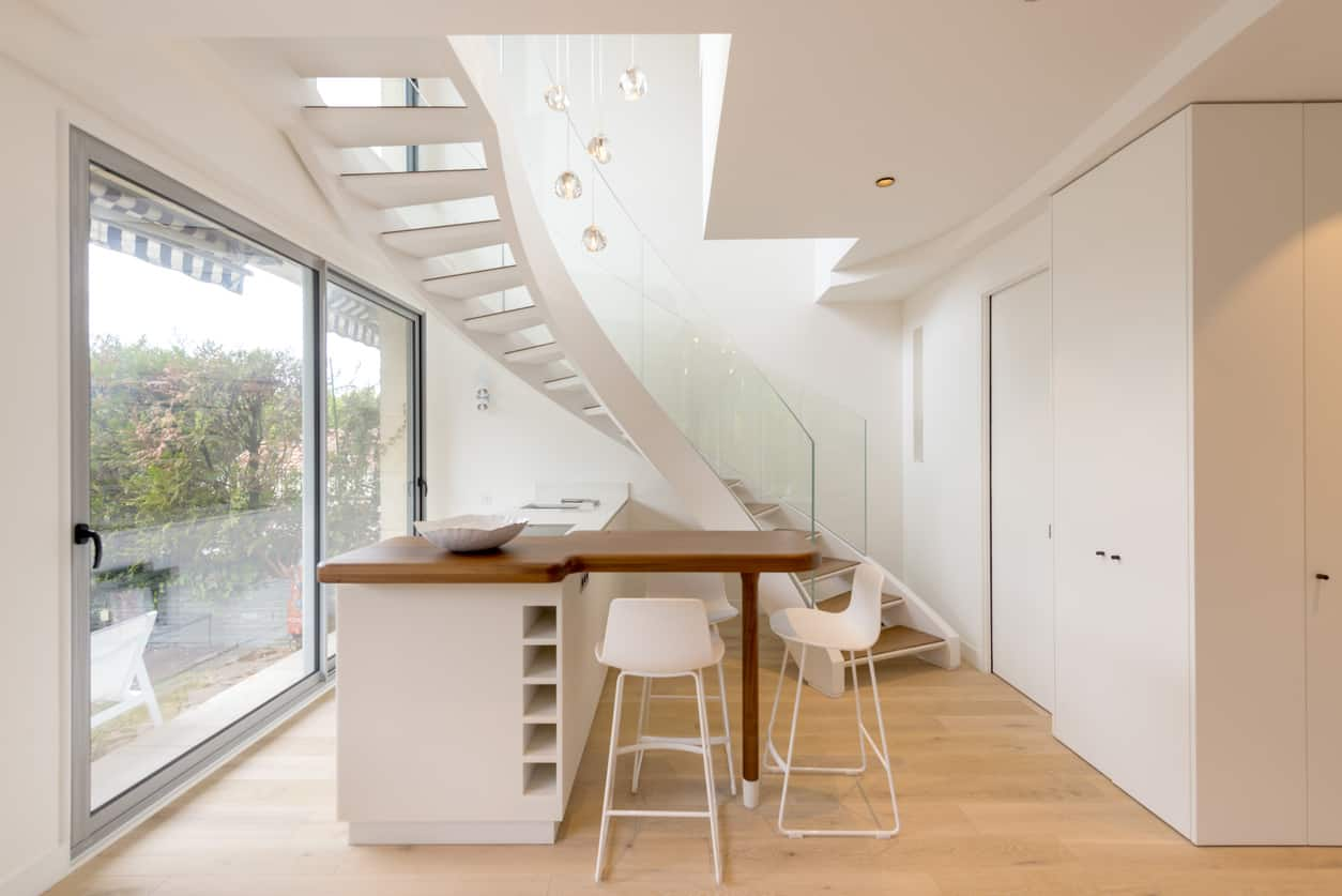 White Curving Staircase Into Kitchen Oct1